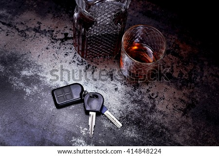 Luxury decanter of whiskey and a glass at the bar. Leisure concept, alcohol, alcoholic beverages. Strong brandy in a glass and car keys on a table in a bar or restaurant - stock photo