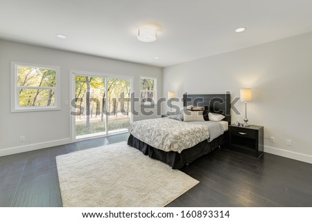 Luxury decorated bedroom with a view of nature. - stock photo