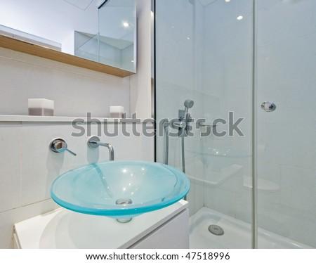luxury designer en-suite bathroom with glass bowl like hand wash basin - stock photo