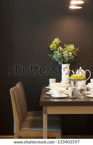 luxury dining table with glass and ceramic dishware.