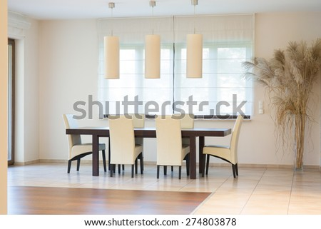 Luxury dinning room with big oak table - stock photo
