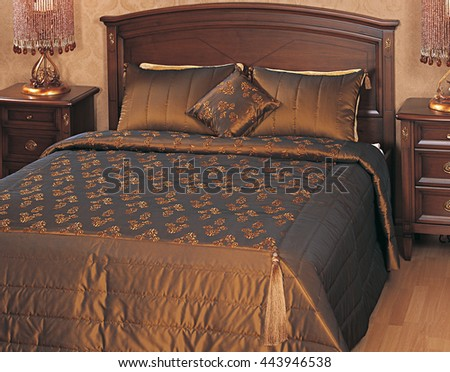 Luxury double bed and elegant brown gold bedspread - stock photo