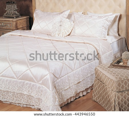Luxury double bed and elegant lace tulle white bedspread - stock photo