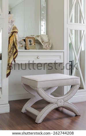 luxury dressing chair with female's accessories on table at home