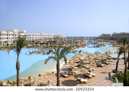 luxury egyptian resort hotel with the Red Sea in the background - stock photo