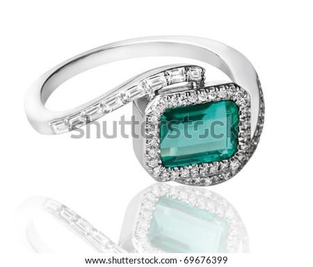 luxury emerald ring decorates by diamonds isolated on white background  - stock photo