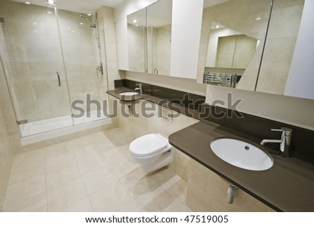 luxury en-suite bathroom with two hand wash basins