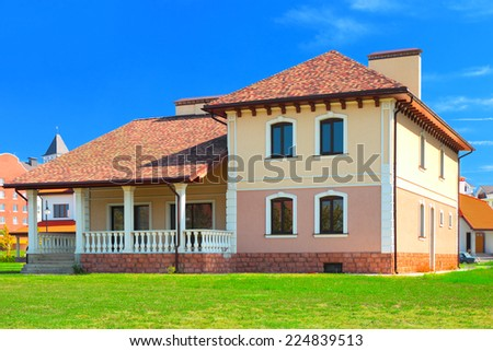 Luxury european  house at sunny day at green lawn