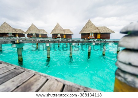 Luxury exclusive restorts floating water bungalows on the azure water of the Maldives Islands