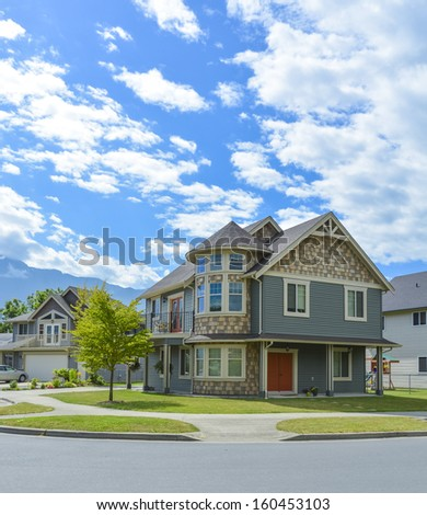 Luxury family house on cloudy, blue sky background in British Columbia, Canada.