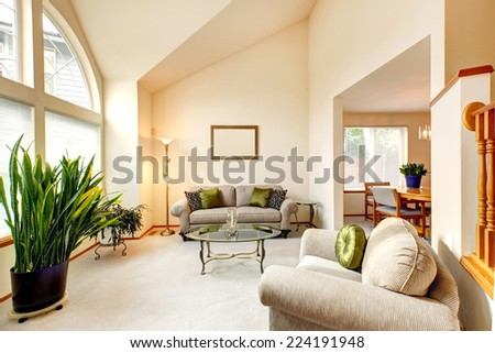Luxury Family Room In Soft Creamy Tones With High Ceiling And Arch Window.  Room With Part 34