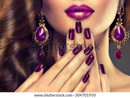Luxury fashion style, nails manicure, cosmetics ,make-up and curly hair . Makeup in shades of purple and violet earrings - stock photo