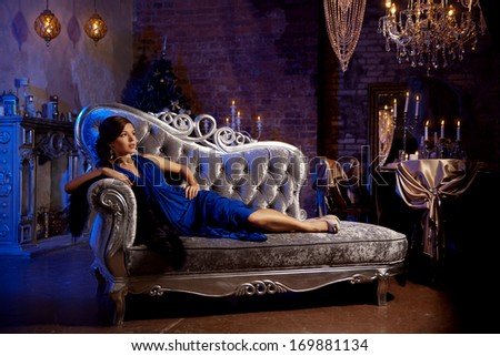 Luxury fashion stylish woman in the rich interior. Beauty girl with a fashionable hairstyle and makeup chic - stock photo