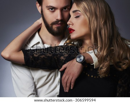 luxury fashionable couple in tender passion. Beautiful woman near the man.beauty girl and boy together - stock photo