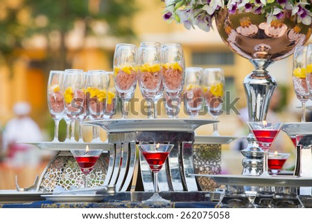 Luxury food and drinks on wedding table. - stock photo