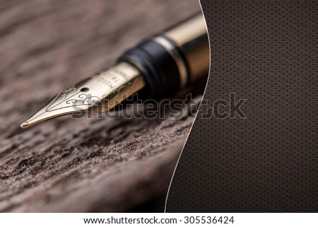 Luxury fountain pen over a wooden surface  with space for text  - stock photo