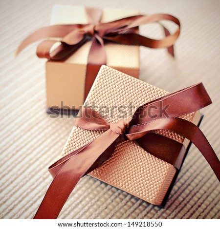 Luxury gift boxes with ribbon, retro filter effect  - stock photo