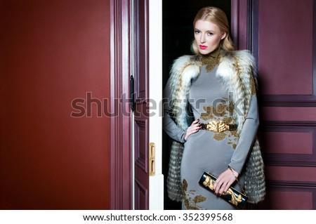 luxury girl in red interior - stock photo