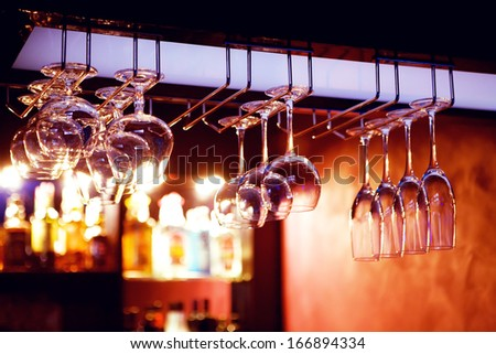 Luxury glasses for alcohol on a bar counter  - stock photo