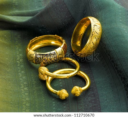 Luxury gold bracelets in Thai  ancient style - stock photo