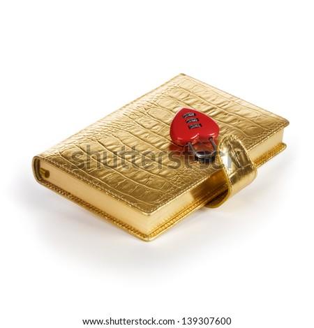 Luxury golden diary with heart shape padlock on white background - stock photo