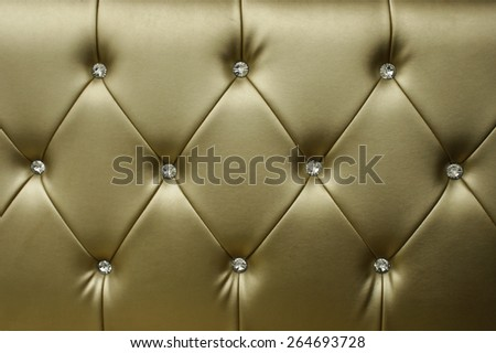 Luxury golden leather close-up background - stock photo