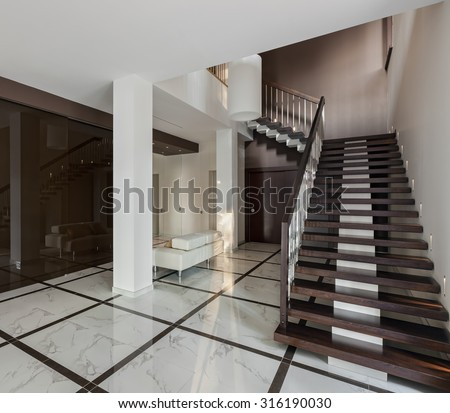 Luxury hall with staircase and glass wardrobe in modern style - stock photo
