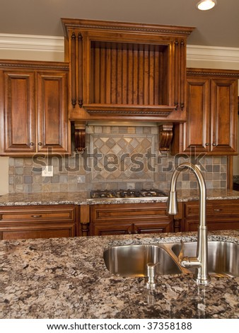 Luxury Home dark wood kitchen with faucet - stock photo