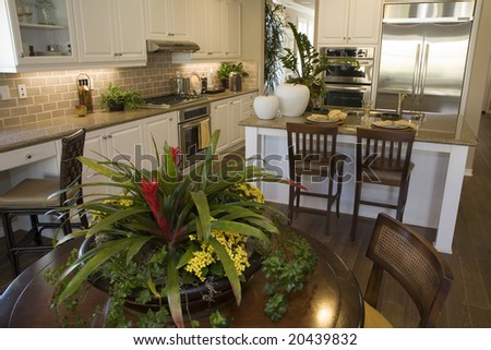 Luxury home dining room and a modern kitchen. - stock photo