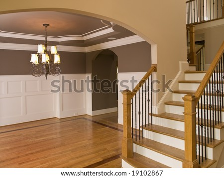 Luxury Home Entrance way with Descending Staircase - stock photo