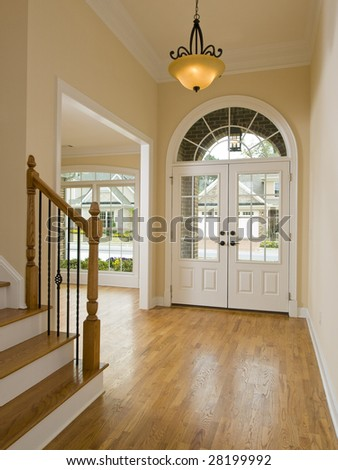 Luxury Home Foyer Door and Staircase with light - stock photo