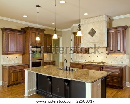 Luxury Home Interior Kitchen with center Island - stock photo