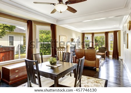 Luxury Home Interior With Black Dining Table Set And Antique Brown Chest.  View Of Family