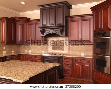 Luxury Home Kitchen with center island and cabinets - stock photo