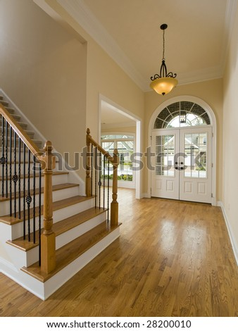 Luxury Home Staircase and Foyer with hanging light - stock photo