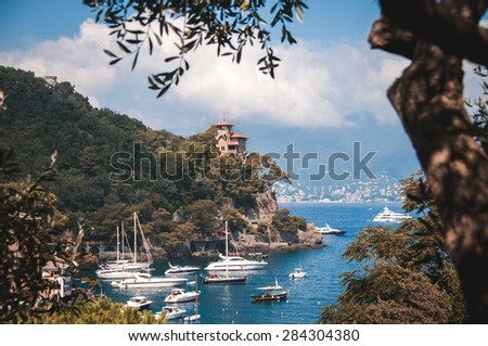 luxury home surrounded the port of Portofino, with the beach and luxury boats - stock photo