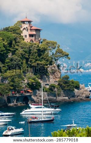 Luxury homes and yacht along the Italian coast at Portofino - stock photo