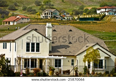 Luxury homes in the hills of a golf course - stock photo