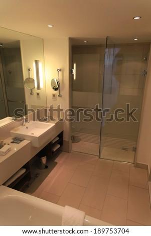 luxury hotel bathroom, and shower - stock photo