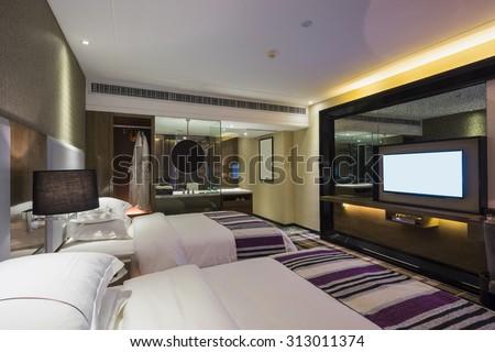 luxury hotel bedroom with nice decoration - stock photo