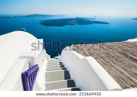 Luxury hotel with sea view. White architecture on Santorini island, Greece. Beautiful summer landscape - stock photo