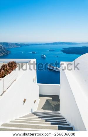 Luxury hotel with sea view. White architecture on Santorini island, Greece. Beautiful summer landscape - stock photo