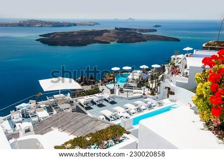 Luxury hotel with sea view. White architecture on Santorini island, Greece. Beautiful view on the sea - stock photo
