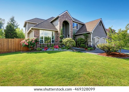 luxury house exterior with brick and siding trim and double garage well kept garden around - Luxury Homes Exterior Brick