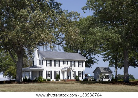 Luxury House in a oak shadows. - stock photo