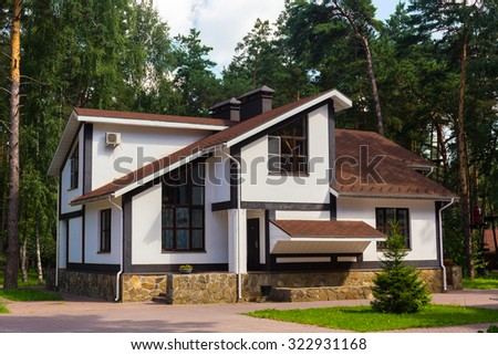 Luxury house in the forest - stock photo