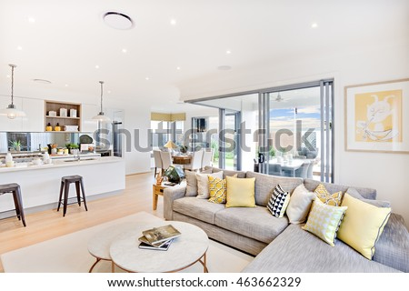 round table living room. Luxury house interior focusing the living room sofa and pillows next round  table on carpet House Interior Focusing Living Room Stock Photo Royalty Free