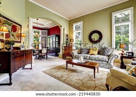 Luxury house interior. Light green family room with antique cabinets and sofa - stock photo
