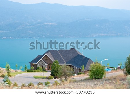 Luxury house with beautiful view over fantastic mountain lake in Vancouver, Canada. - stock photo