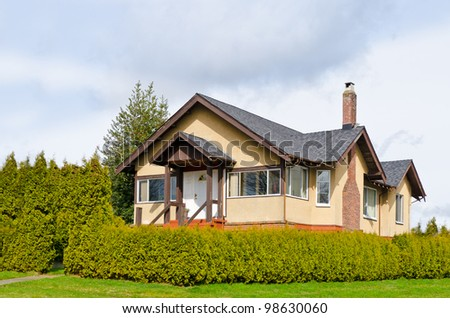 Luxury house with rich green in Vancouver, Canada. - stock photo